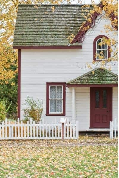 home with a white picket fence