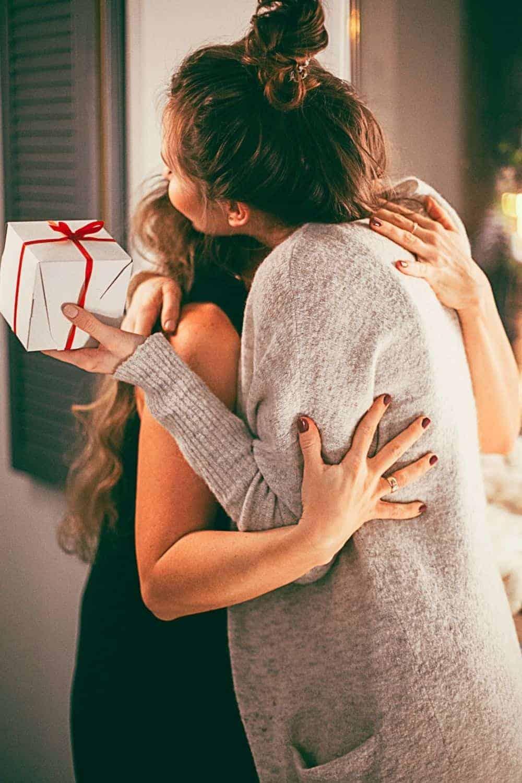 women giving a gift