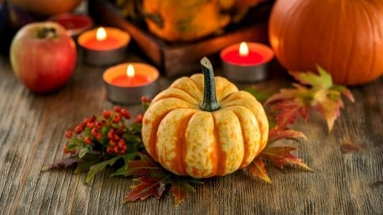 pumpkins and candles as fall decor