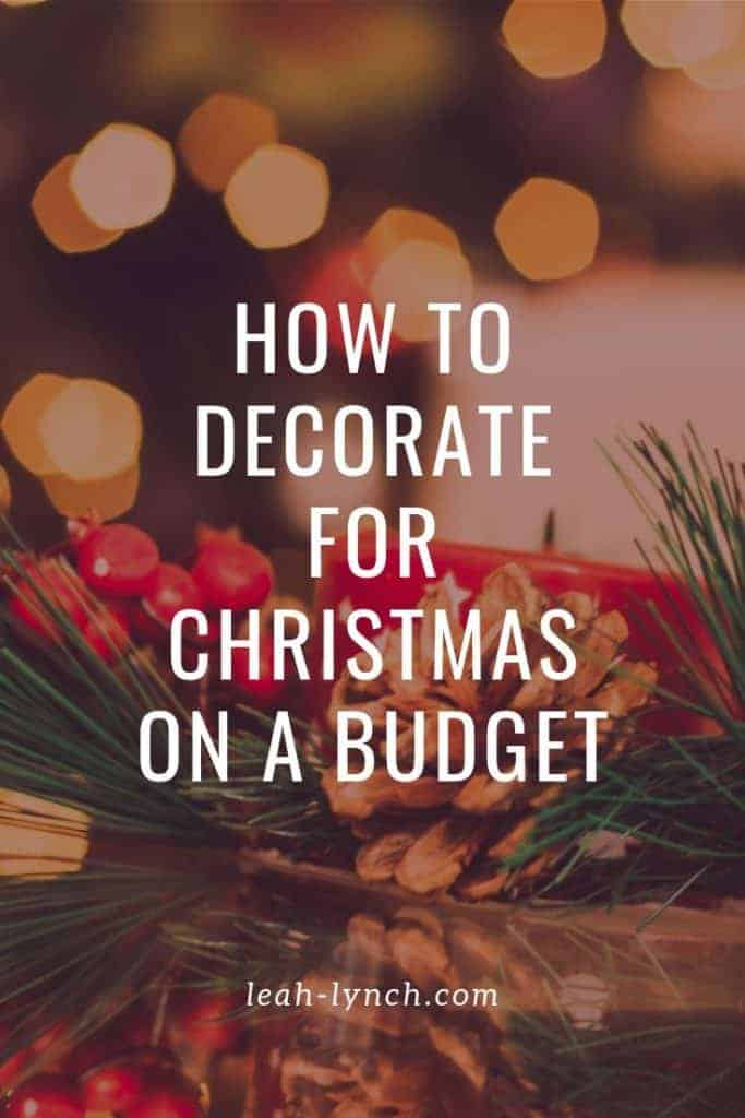 pin image for the blog post with text overaly, how to decorate for Christmas on a budget