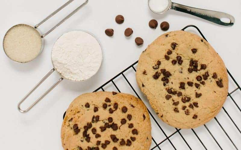 cookies, measuring spoons with flower, chocolate chips